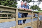 Steve Swann, left, and Kelly Wright on a 4.6m Clearwater Crossings bridge they have installed on John and Bev Manderson's property at Kauri. Photo / John Stone