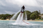 Aaron Ridgway cools off using his water-powered jet pack. Photo / Chris Gorman