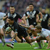 Issac Luke of New Zealand is tackled by Sam Tomkins of England. Photo / Getty Images