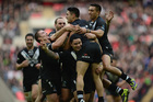 Shaun Johnson of New Zealand celebrates with team mate Issac Luke during the Rugby League World Cup Semi Final match. Photo / Getty Images