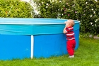 Fencing backyard swimming pools won't save neighbourhood kids from streams or rivers in the area. Photo / Getty Images