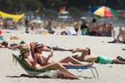 Sunbathers were loving every minute of the fine weather at Mt Maunganui. Photo / Alan Gibson
