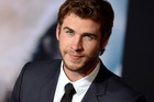 Liam Hemsworth nearly lost the tip of his finger recreating a knife game from his school days. Photo / AP