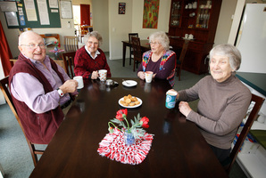 Residents, from left: Tim Holderness, 79, Mary Campbell, 89, Annie Middleton, 82, and Elva Harris, 86, enjoy a cup of tea in the shared kitchen/dining area. Photo / Christine Cornege