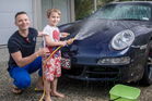 Nic Watt and son Luca wash his Porsche 911 Targa every week. Picture / Ted Baghurst