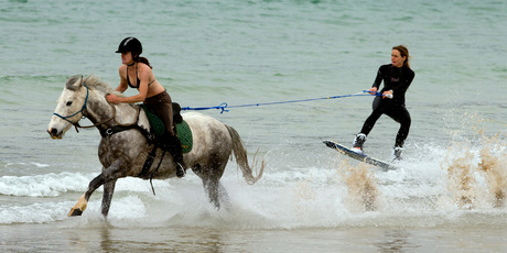 Chloe Phillips-Harris and her horse Fern tow wakeboarder Nikita Osborne at high speed at Matauri Bay.