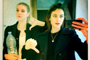 It girl Alexa Chung, right, takes a selfie with a girlfriend. Photo / Supplied.
