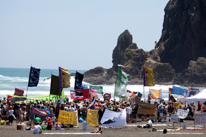 People show their opposition to deep sea oil drilling in New Zealand waters at the 'banners on the beach' event at Piha. Photo / Greenpeace / Alex Monteith
