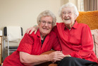 Newly united sisters Merle Coleman (left) and Iris Lonergan found they'd worn the same colours. Photo / Greg Bowker