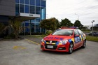 New red and orange Police road safety cars launched 26 November 2013 ahead of the New Zealand summer crackdown on speeding motorists.
