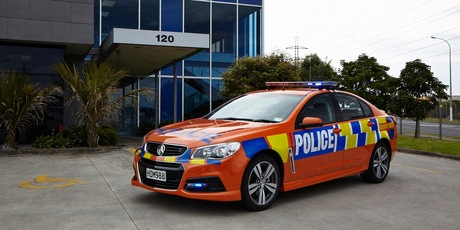 The new red and orange police road safety cars which will patrol New Zealand roads throughout summer.