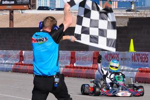 Christchurch karter Matthew Hamilton  greets the chequered flag to win the S4 Masters Stock Moto class at the 17th annual SKUSA SuperNationals meeting in Las Vegas