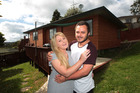 Jenna Close and Jamie Clark at the Glen Eden home their parents helped them buy. Photo / Doug Sherring
