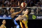 Corey Webster of the Breakers attempts to score past the outstretched arms of Chris Goulding of the Melbourne Tigers. Photo / Getty Images