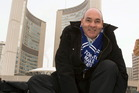 George Smitherman laces up his skates in front of City Hall after registering in the Toronto mayoral race. Photo / AP