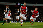 Arsenal's Olivier Giroud, center, celebrates scoring a penalty and his second goal of the game during the English Premier League soccer match between Arsenal and Southampton. Photo / AP