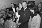 Lyndon B. Johnson is sworn in as president as Jacqueline Kennedy stands at his side, in her famous bloodstained pink suit. Photo / AP Images