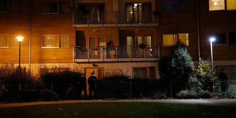 Police officers stand outside properties in the area where three women were freed in south London. Photo / AP