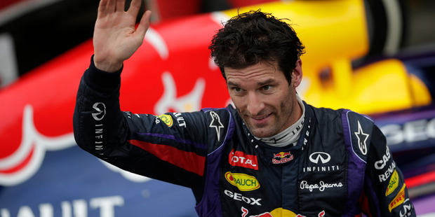 Red Bull driver Mark Webber of Australia, celebrates after coming in second place on the Brazilian Formula One Grand Prix at the Interlagos racetrack in Sao Paulo, Brazil. Photo / AP