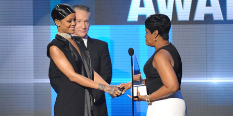 Monica Fenty, right, presents the Icon award to her daughter, Rihanna, on stage at the American Music Awards. Photo / AP