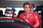 In this Nov. 15, 2013 file photo, Juan Pablo Montoya, of Colombia, climbs into his car for NASCAR practice at Homestead-Miami Speedway. Photo / AP
