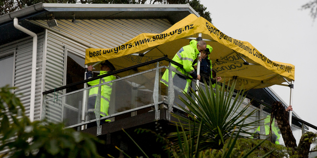 Police at the scene of the property on Takahe Rd, Titirangi, West Auckland. Photo / NZ Herald