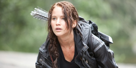 Jennifer Lawrence as Katniss, a role model for a new generation of young women.