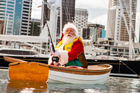 Santa Claus tries a spot of fishing in Auckland.