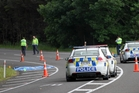 Police at the incident where a girl was run over near Rotorua. Photo / SNPA