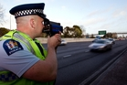 Steve Butler-Jones of the Auckland motorway police unit checks traffic speed levels with the Stalker laser gun.