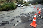 Flood water washed away a section of Kaimata Rd near Bay View last night. Photo/Paul Taylor.