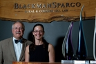 ADDING VALUE: Ian Blackman and receptionist Sarah Homan with some of Blackman Spargo's awards in an office designed to resemble a farmhouse.PHOTO/STEPHEN PARKER 261113SP2
