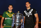 Australian captain Cameron Smith and Kiwis skipper Simon Mannering with the rugby league World Cup. Photo / Getty Images