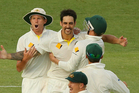 Mitchell Johnson of Australia celebrates after taking the wicket of James Anderson of England to claim victory. Photo / Getty Images