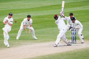 Shane Shillingford drives the ball for four runs at University Oval yesterday. Photo / Getty Images