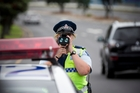 Constable Jackie Pearce stopped five drivers within 30 minutes along Quay Street yesterday, all over the new 4km/h speed threshold. Photo / Greg Bowker