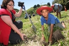 Clare Ridler from Horizons Regional Council and student Te Maramatanga Ponga, 9, plant native species at the Awarua Stream. PHOTO/BEVAN CONLEY