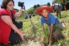 Clare Ridler from Horizons Regional Council and student Te Maramatanga Ponga, 9, plant native species at the Awarua Stream. PHOTO/BEVAN CONLEY