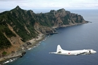 A Japanese surveillance plane flies over the disputed islands. Photo / AP