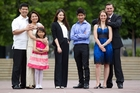From left, new citizens Marlon and Maida Macatual with daughter Maive, from the Philippines, Cecilia Liu from China, Patamyai Hla from Burma and Sherene Marais and Gareth Poley from South Africa. Photo / Richard Robinson