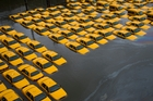 A parking lot of yellow taxis was flooded during Hurricane Sandy. Photo / AP