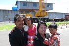 The Constantino family of Dargaville outside Ngawha prison yesterday as their new house built by prisoners was lifted over the wire. Photo/Peter de Graaf.