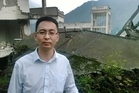 Liu Zhihong, mayor of Yingxiu, stands among the ruins of the Xuankou Middle School.