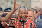 Nelson Mandela waves to the crowds after visiting St Matthew-in-the-City, in Auckland. File photo / NZ Herald