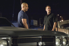 Vin Diesel and Paul Walker in the first Fast & Furious film.