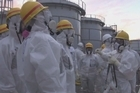 """UN nuclear experts praise Japan for making progress on shutting down the crippled Fukushima plant, but warn the situation there remains """"very complex""""."""