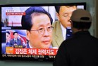 A South Korean man watches TV news about the dismissal of Jang Song-Thae. Photo / AFP