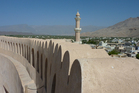 A view over the thick, curved walls of Oman's impressive Nizwa Fort. Photo / Megan Singleton