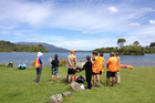 Search and rescue team members on the shore of Lake Tarawera. Photo / Christine Cornege