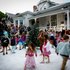 Children playing in the snow machine at 30 Franklin Road. Fake snow was brought in and it covered the front lawn at the property. Photo / Sarah Ivey